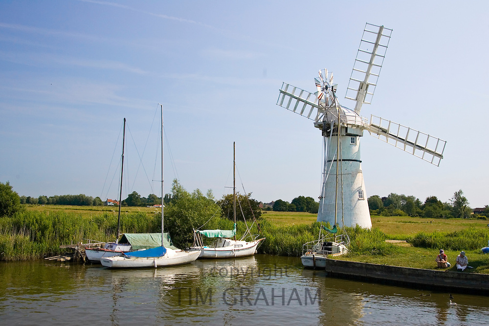Windmill and moored sailing boats on the Norfolk Broads, United Kingdom