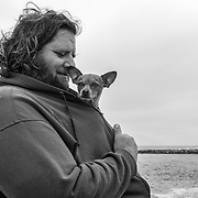 Eric comforts his dog Goldy on Moss Landing State Beach in Moss Landing, Calif. on Sept. 13, 2021.