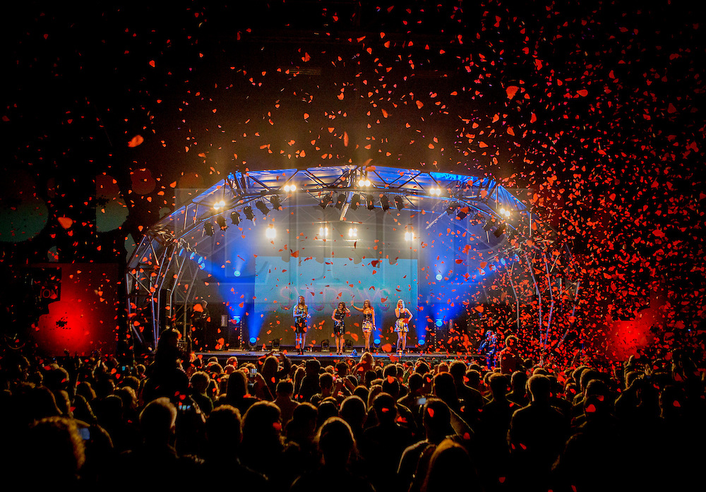 © Licensed to London News Pictures. 24/10/2013. RAF Northolt, Middlesex, London.  The 2013 Royal British Legion Poppy Appeal launched at a special concert in a busy military base in London this evening.  Members of the Armed Forces and their families were entertained by a number of performers which included the Saturdays, Union J, Tich, the Luminites and the first all girl group formed from Armed Forces families, The Poppy Girls. <br /> <br /> The Poppy Girls – Megan, Florence, Alice, Bethany and Charlotte – all have fathers currently serving in the Royal Navy, Army and Royal Air Force.  Photo credit: Alison Baskerville/LNP
