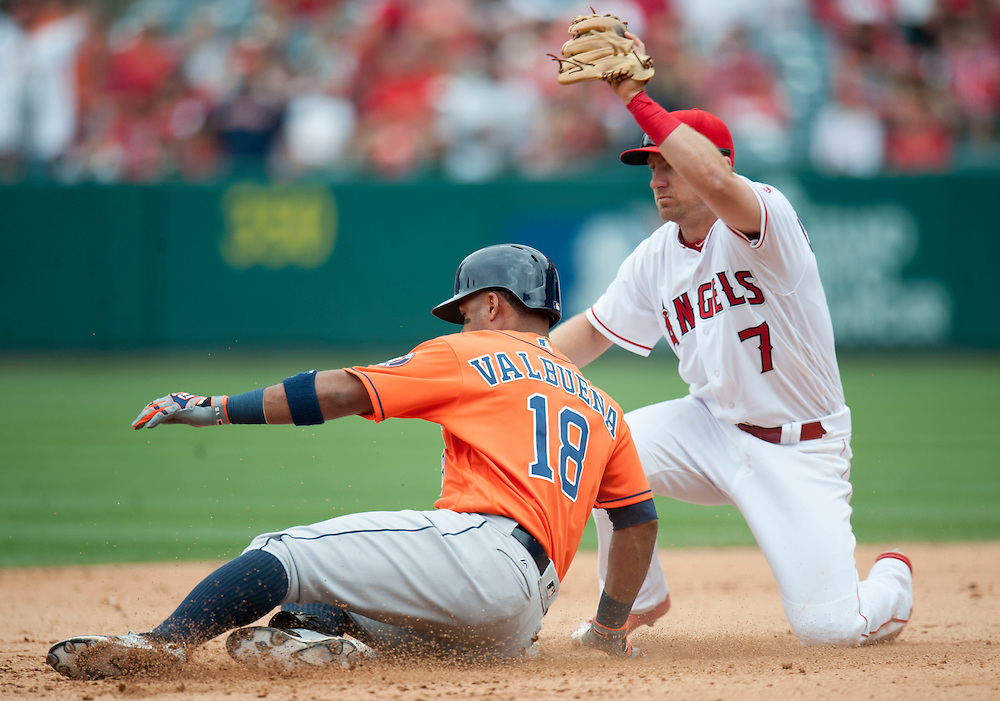The Angels' Cliff Pennington tags out Houston's Luis Valbuena trying to stretch in the eighth inning during the Angels' 13-inning 8-6 loss to the Houston Astros Sunday at Angel Stadium. <br /> <br />  //ADDITIONAL INFO:   <br /> <br /> angels.0530.kjs  ---  Photo by KEVIN SULLIVAN / Orange County Register  -- 5/29/16<br /> <br /> The Los Angeles Angels take on the Houston Astros Sunday at Angel Stadium.