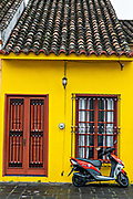 A brightly painted colonial style home in Tlacotalpan, Veracruz, Mexico. The tiny town is painted a riot of colors and features well preserved colonial Caribbean architectural style dating from the mid-16th-century.