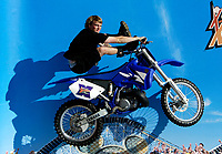 """Jul 01, 2003; Anaheim, California, USA; Professional In-line Skater MATT LINDENMUTH trys out a motobike before his first gig performing live at Disney's California Adventure """"X Games Experience"""".  Disney park has built two X-Arena's specifically for this 41 day event highlighting extreme sports for the launch of the 2003 ESPN X Games.<br />Mandatory Credit: Photo by Shelly Castellano/Icon SMI<br />(©) Copyright 2003 by Shelly Castellano"""