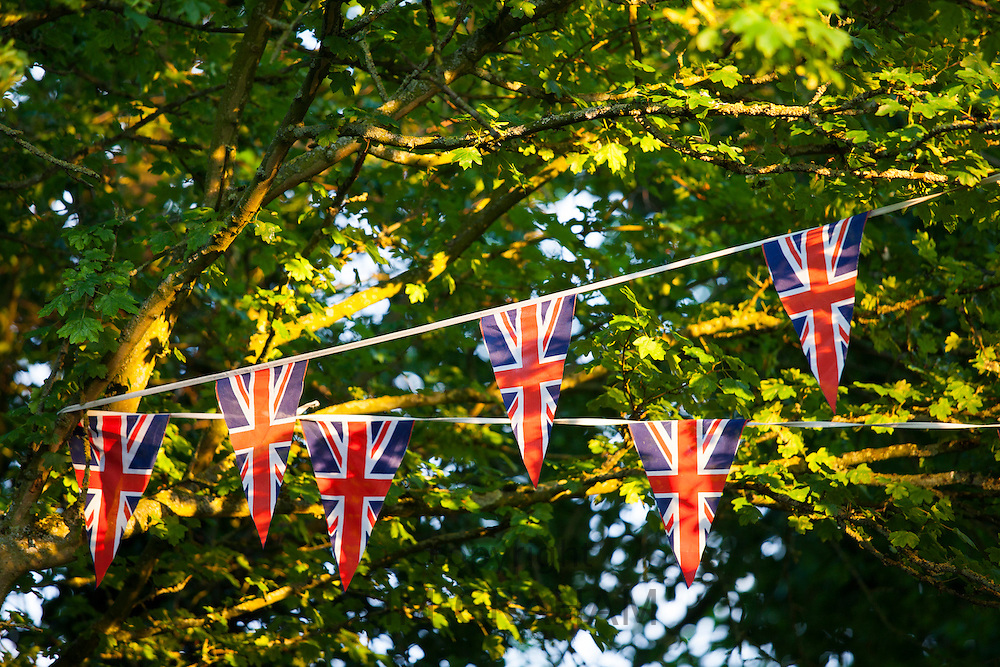 Union Jack flag bunting at street party to celebrate the Queen's Diamond Jubilee in Swinbrook in the Cotswolds, UK