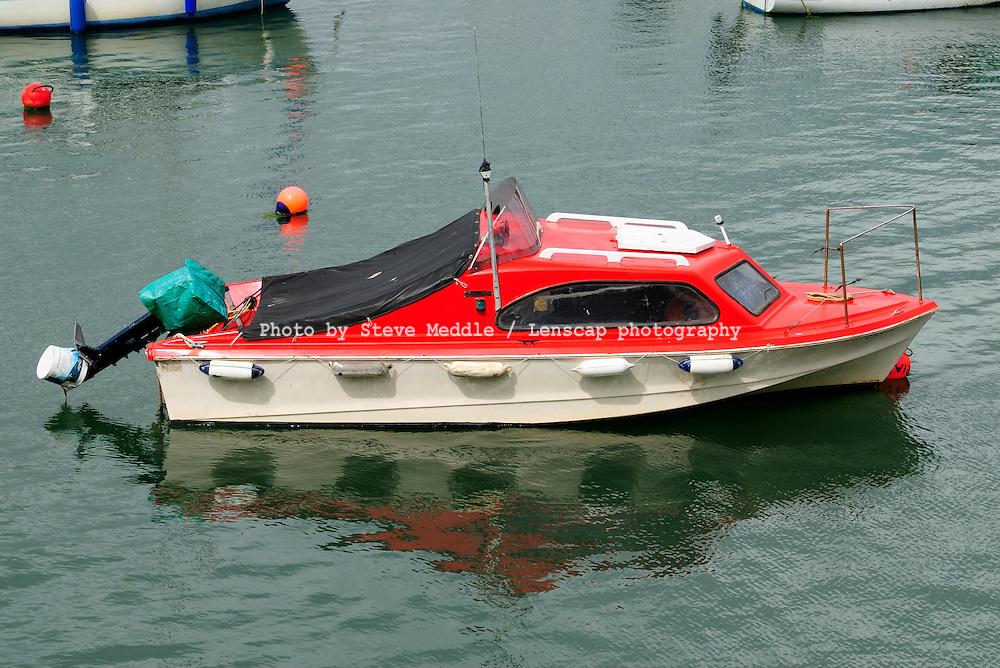 Small Boat Moored in Harbour, Goodrington Sands Paignton Devon Britain.