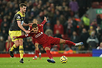 Football - 2019 / 2020 Premier League - Liverpool vs. Southampton<br /> <br /> Liverpool's Roberto Firmino is founded by Southampton's Jack Stephens<br /> <br /> Colorsport / Terry Donnelly