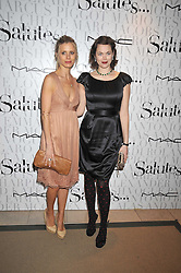 Left to right, LAURA BAILEY and JASMINE GUINNESS at the MAC Salutes party paying tribute to renowned makeup artists held at The Hosptal, Endell Street, London on 22nd February 2009.