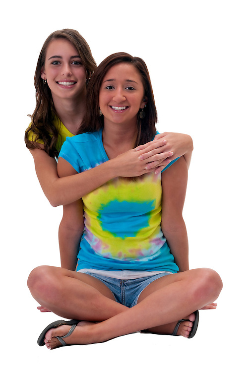 Multiracial friends very cheerful seated in the floor playful.