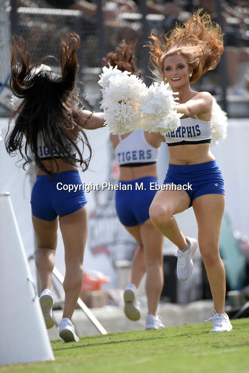 Memphis dancers perform on the sideline during the first half of the American Athletic Conference championship NCAA college football game against Central Florida Saturday, Dec. 2, 2017, in Orlando, Fla. (Photo by Phelan M. Ebenhack)