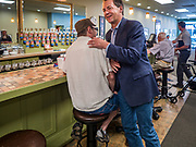 10 JULY 2019 - MARSHALLTOWN, IOWA: Governor STEVE BULLOCK (D-MT) greets voters during a campaign stop at a cafe in Marshalltown Wednesday. Gov. Bullock is in a crowded field of Democrats vying to be the party's Presidential nominee in 2020. Iowa traditionally hosts the the first election event of the presidential election cycle. The Iowa Caucuses will be on Feb. 3, 2020.        PHOTO BY JACK KURTZ