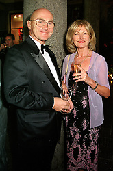 Leading buisiness woman MISS DEBBIE MOORE and MR TOM <br /> BERGLUND, at a reception in London on 4th July 2000.OGA 48<br /> © Desmond O'Neill Features:- 020 8971 9600<br />    10 Victoria Mews, London.  SW18 3PY <br /> www.donfeatures.com   photos@donfeatures.com<br /> MINIMUM REPRODUCTION FEE AS AGREED.<br /> PHOTOGRAPH BY DOMINIC O'NEILL