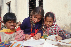 Group of primary school children working at table outdoors in primary school in Patiala; Punjab; India,
