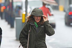 ©Licensed to London News Pictures 30/10/2020  <br /> Sevenoaks, UK. A lady holding onto her hood. The October wet weather continues today for shoppers in Sevenoaks High Street in Kent. The Met office has issued a weather warning for parts of the UK for heavy rain and strong winds which could bring some flooding. Photo credit:Grant Falvey/LNP