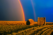 Bales and double rainbow after storm at sunset<br />Cypress River<br />Manitoba<br />Canada