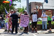 Mifflinburg Police Chief Jeffrey Hackenburg talks to demonstrators during the Mifflinburg Pride Event.