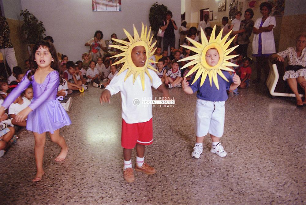 Nursery school children taking part in school play wearing costumes,