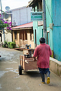 Man pushing a cart on the street in the town of El Castillo, Rio San Juan Department, Nicaragua