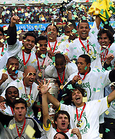 25/07/04 - LIMA - PERU -  COPA AMERICA PERU 2004 -  BRASIL - BRAZIL (5) win by penalty  over ARGENTINA (3) - BRAZIL CHAMPION CELEBRATION.<br />Brazilian Player receiving the cup and celebrating.<br />In the picture DIEG - ADRIANO - and others.<br />©G.P./Argenpress.com