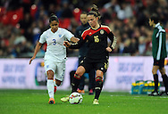 Melanie Leupolz of Germany Women is chased by Demi Stokes of England Women<br /> - Womens International Football - England vs Germany - Wembley Stadium - London, England - 23rdNovember 2014  - Picture Robin Parker/Sportimage
