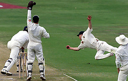 South Africa fielder Jonty Rhodes makes a flying catch, but the umpire gave Andrew Caddick not out, during the third day of the 1st Test between England and South Africa at the Wanderers Cricket ground, Johannesburg.