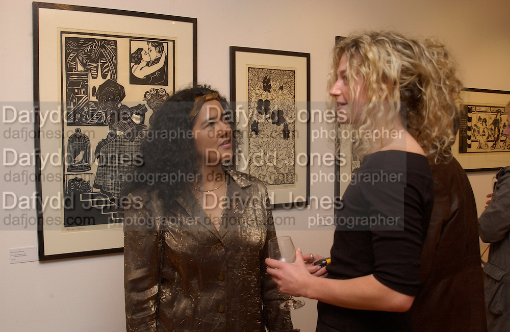 Martha Satizabal and Lucy Copes, Nicholas Garland prints and drawings, Fine Art Society. 13 May 2003. © Copyright Photograph by Dafydd Jones 66 Stockwell Park Rd. London SW9 0DA Tel 020 7733 0108 www.dafjones.com