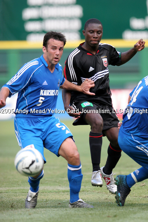 9 July 2005: Kerry Zavagnin (5) holds off Freddy Adu (r). The Kansas City Wizards defeated DC United 1-0 at RFK Stadium in Washington, DC in a regular season Major League Soccer game. .