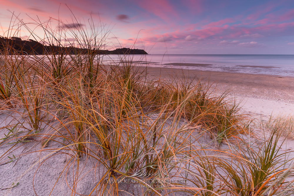 Ten days of stormy rain and winds ends with dispersing clouds, making for a nice sunset over Onetangi Beach, Waiheke Island, New Zealand.