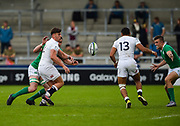 England centre  Johnny Williams feeds the ball on to England centre Joe Marchant during the World Rugby U20 Championship Final   match England U20 -V- Ireland U20 at The AJ Bell Stadium, Salford, Greater Manchester, England onSaturday, June 25, 2016. (Steve Flynn/Image of Sport)