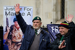 © Licensed to London News Pictures. 07/02/2017. London, UK. A former Royal Marine waves at passing traffic beeping their horns, outside the Royal Courts of Justice in London, to show support for Sgt Blackman, who is due to start an appeal against his life sentence for the murder of a wounded Taliban fighter in Afghanistan in 2011.  Photo credit: Ben Cawthra/LNP