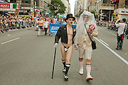 A costumed couple marching in the 2011 Pride Parade on New York's Fifth Avenue pose for a photo opportunity.