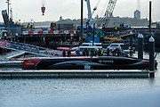 """""""Te Aihe"""", Emirates Team New Zealand's first AC75 is prepared for her christening. Viaduct Harbour, Auckland, New Zealand."""