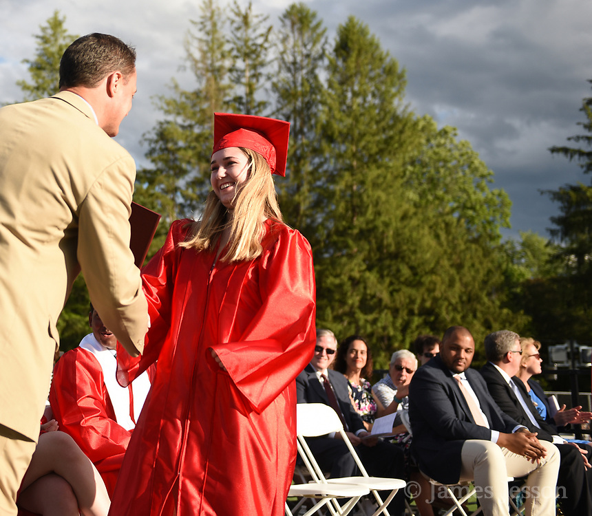 Tess Buckley receives her diploma from principal Dr. Jamie Chisum during the 148th Graduation exercises at Wellesley High School on June, 2, 2017.   [Wicked Local Photo/James Jesson]