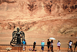 June 20, 2017 - Turpan, Turpan, China - Turpan, CHINA-June 19 2017: (EDITORIAL USE ONLY. CHINA OUT)..The Flaming Mountains are barren, eroded, red sandstone hills in Tian Shan Mountain range, Xinjiang, China. They lie near the northern rim of the Taklamakan Desert and east of the city of Turpan. Their striking gullies and trenches caused by erosion of the red sandstone bedrock give the mountains a flaming appearance at certain times of the day. The mountain climate is harsh, and the extremely high summer temperatures make this the hottest spot in China, frequently reaching 50 ¡ãC (122 ¡ãF) or higher. One of the largest thermometers in China¡ªa popular tourist spot¡ªis on display adjacent to the mountain, tracking the surrounding air temperature. (Credit Image: © SIPA Asia via ZUMA Wire)