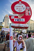 01 MARCH 2013 - BANGKOK, THAILAND: <br /> A Pheu Thai supporter wears face paint and placards with 9 on them. 9 is the number of the Pheu Thai Gubernatorial candidate, Pongsapat Pongcharoen, on the ballot. The election is Sunday, March 3 and no campaigning is allowed 24 hours before election day. Police General Pongsapat Pongcharoen (retired), a former deputy national police chief who also served as secretary-general of the Narcotics Control Board is the Pheu Thai Party candidate in the upcoming Bangkok governor's election. He resigned from the police force to run for Governor. Former Prime Minister Thaksin Shinawatra reportedly personally recruited Pongsapat. Most of Thailand's reputable polls have reported that Pongsapat is leading in the race and likely to defeat Sukhumbhand Paribatra, the Thai Democrats' candidate and incumbent. The loss of Bangkok would be a serious blow to the Democrats, whose national base has been the Bangkok area.   PHOTO BY JACK KURTZ