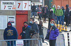 © Licensed to London News Pictures 03/01/2021.        Charlton, UK. People queuing outside the ground. A Coronavirus testing centre has been set up by Greenwich Council at Charlton Athletic's football stadium in South East London to rapid test secondary school students and staff. <br /> The rapid test should give results in 30 minutes. Photo credit:Grant Falvey/LNP