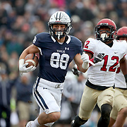 NEW HAVEN, CONNECTICUT - NOVEMBER 18: JP Shohfi #88 of Yale is chased by Isaiah Wingfield #12 of Harvard during the Yale V Harvard, Ivy League Football match at the Yale Bowl. Yale won the game 24-3 to win their first outright league title since 1980. The game was the 134th meeting between Harvard and Yale, a historic rivalry that dates back to 1875. New Haven, Connecticut. 18th November 2017. (Photo by Tim Clayton/Corbis via Getty Images)