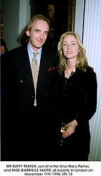 MR BUFFY PARKER, son of writer Una-Mary Parker, and MISS GABRIELLE SALTER, at a party in London on November 11th 1996.LTK 13