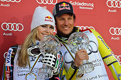 15-03-2012 SKIEN: FIS WORLD CUP 2012: SCHLADMING<br /> Lindsey Vonn of USA and Aksel Lund Svindal of Norway Worldcup Champions of SuperG Worldcup with SuperG crystal globe during SuperG Worldcup winner ceremony of FIS Ski Alpine World Cup at Planai Stadium in Schladming<br /> **NETHERLANDS ONLY** <br /> ©2012-FotoHoogendoorn.nl/EXPA/Sandro Zangrando