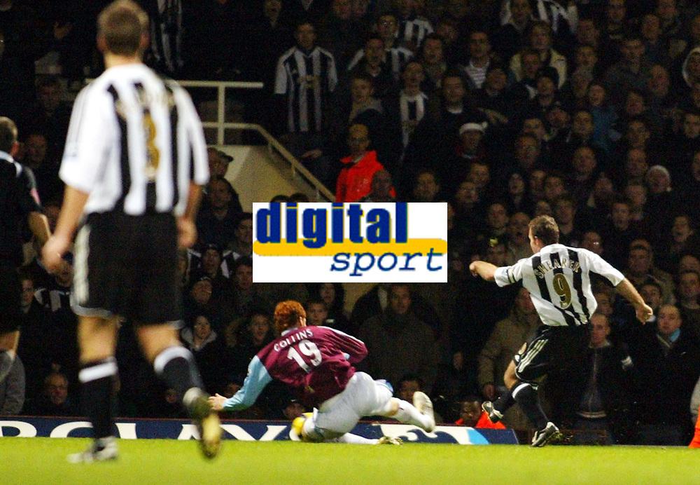 Photo: Chris Ratcliffe.<br />West Ham United v Newcastle United. The Barclays Premiership. 17/12/2005.<br />Alan Shearer (R) scores his goal as James Collins closes him down.