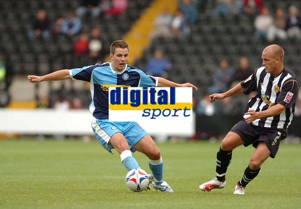 Photo: Leigh Quinnell.<br /> Notts County v Wycombe Wanderers. Coca Cola League 2. 12/08/2006. Wycombes Matt Bloomfield keeps the ball from Notts Countys David Pipe.