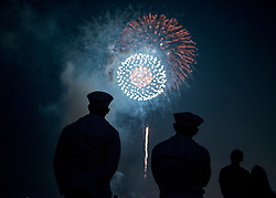 YOKOSUKA, Japan (Aug. 4, 2018)  Sailors enjoy fireworks during the 42nd annual Yokosuka Friendship Day celebration onboard U.S. Fleet Activities (FLEACT) Yokosuka. The open base event highlights the friendship between the U.S. Navy and Japan.  FLEACT Yokosuka provides, maintains, and operates base facilities and services in support of U.S. 7th Fleet's forward-deployed naval forces, 71 tenant commands, and 27,000 military and civilian personnel. (U.S. Navy photo by Garrett Zopfi)180804-N-GH917-1008