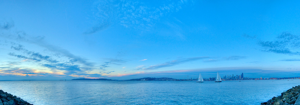 Panoramic photograph of the Puget Sound with Seattle, Washington in the distance.  Print Size (in inches): 15x5; 24x8.5; 36x12.5; 40x14; 48x17; 60x21; 72x25.5.