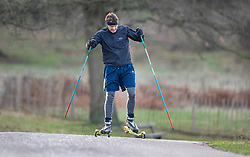 © Licensed to London News Pictures. 18/01/2019. London, UK. A man uses a pair of roller skis to make his way through Richmond Park at first light as freezing temperatures and snow hit parts of the UK. Photo credit: Peter Macdiarmid/LNP