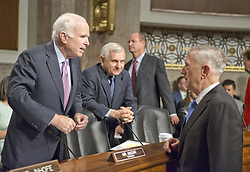 June 13, 2017 - Washington, District of Columbia, United States of America - United States Secretary of Defense JAMES N. MATTIS, right, speaks with United States Senator JOHN MCCAIN (Republican of Arizona), Chairman, US Senate Committee on Armed Services, left, and US Senator Jack Reed (Democrat of Rhode Island), Ranking Member, US Senate Committee on Armed Services, center, prior to giving testimony before the committee on ''the Department of Defense budget posture in review of the Defense Authorization Request for Fiscal Year 2018 and the Future Years Defense Program'' on Capitol Hill. (Credit Image: © Ron Sachs/CNP via ZUMA Wire)
