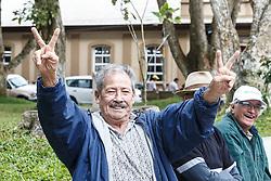 Men flashing victory sign, San Ramon, Alajuela, Costa Rica, Costa Rica.Costa Rica.