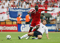 Photo: Chris Ratcliffe.<br /> England v Trinidad & Tobago. Group B, FIFA World Cup 2006. 15/06/2006.<br /> Frank Lampard from England clashes with Aurtis Whitley from T&T.