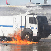 A riot police water cannon burns after a molotov cocktail hit it during clashes at Taksim Square Istanbul, Turkey, 11 June 2013. Turkey's crackdown on opposition protesters that reports said left at least two dead and more than 1,000 injured was 'truly disgraceful,' Amnesty International said 02 June, on a third day of the demonstrations. Demonstrations against the Islamic-conservative government of Prime Minister Recep Tayyip Erdogan began on 31 May when a police crackdown against a peaceful sit-in staged by environmentalists angered over a development project in Istanbul escalated into larger battles between law enforcement and demonstrators. Photo by AYKUT AKICI/TURKPIX