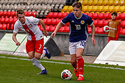 Kai Kennedy (Rangers FC) gets away from Jakub Kaminski  during the U17 European Championships match between Scotland and Poland at Firhill Stadium, Maryhill, Scotland on 26 March 2019.
