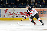 KELOWNA, CANADA, DECEMBER 3: Michael Mylchreest #24 of the Prince George Cougars skates with the puck as the Prince George Cougars visit the Kelowna Rockets  on December 3, 2011 at Prospera Place in Kelowna, British Columbia, Canada (Photo by Marissa Baecker/Shoot the Breeze) *** Local Caption ***