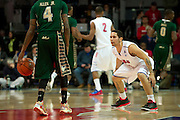 DALLAS, TX - JANUARY 15: Nic Moore #11 of the SMU Mustangs defends Corey Allen Jr. #4 of the South Florida Bulls on January 15, 2014 at Moody Coliseum in Dallas, Texas.  (Photo by Cooper Neill/Getty Images) *** Local Caption *** Nic Moore