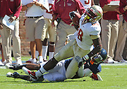 Oct 2, 2010; Charlottesville, VA, USA; Florida State Seminoles wide receiver Willie Haulstead (82) is tackled by Virginia Cavaliers safety Rodney McLeod (4) after making a catch during the first half of the game at Scott Stadium. Photo/The Daily Progress/Andrew Shurtleff